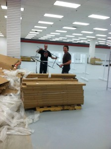 Paul and Matt assembling clothing racks - Impact Thrift Stores Feasterville