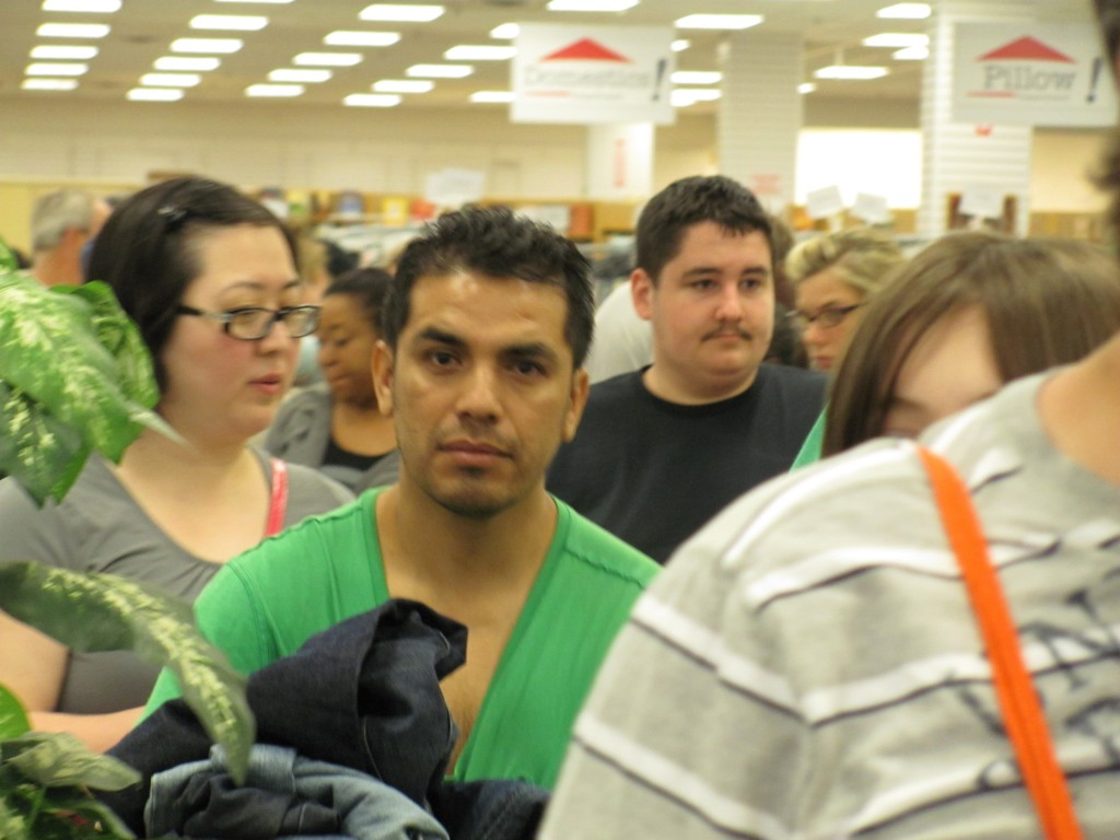 Shoppers wait patiently in line at checkout