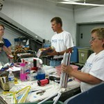 Liberty Mutual staff working side by side with Impact Thrift staff