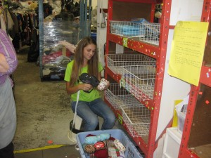 A student from Christopher Dock prices Bric-a-Brac at Impact Thrift Store Montgomeryville