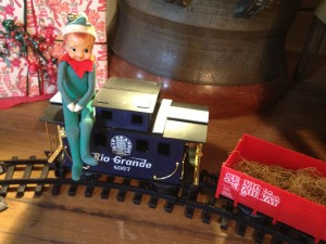 an elf takes a ride on the train at Pearl S. Buck House Festival of Trees 2012