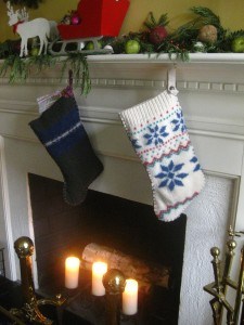Felted Sweater Christmas Stockings hanging from a mantle