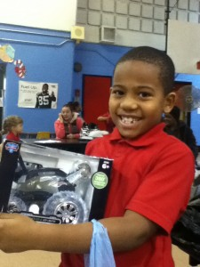 a young man from North Penn School District enjoys his new toy from Impact Thrift Store secret Santa