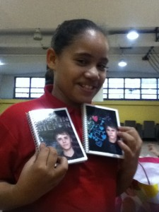 a young lady from North Penn School District with her new Justin Bieber note pads from Impact Thrift Stores secret Santa