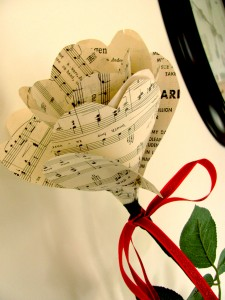 Paper rose created from sheet music Impact Thrift upcycle project