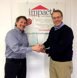Gray Wirth, Impact Thrift Stores President and CEO congratulates Paul Baur and thanks him for all of his years of service as founder of Impact Thrift Stores