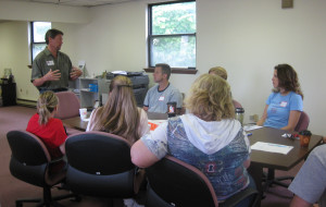 Paul Baur speaks to a group of volunteers from Merck at Impact Thrift Stores Montgomeryville