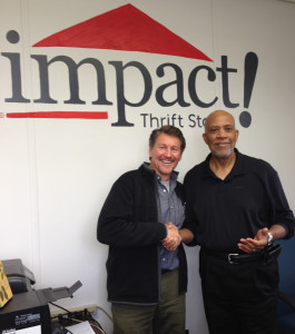 Paul Baur congratulates Warren Johnson on being chosen Impact Thrift Stores Volunteer of the Year