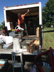 Paul Baur organizes donations at a spring collection drive for Impact Thrift Stores