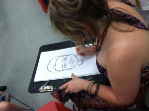 Tara Metz ads her artistic talents to our SpringFest Event, offering free caricatures to young people at Impact Thrift Stores Feasterville SpringFest