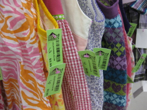 Assorted color price tags allow for sales and specials in the clothing department at Impact Thrift Stores