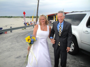 The bride and her dad arrive at the beach in Cape May New Jersey for her wedding
