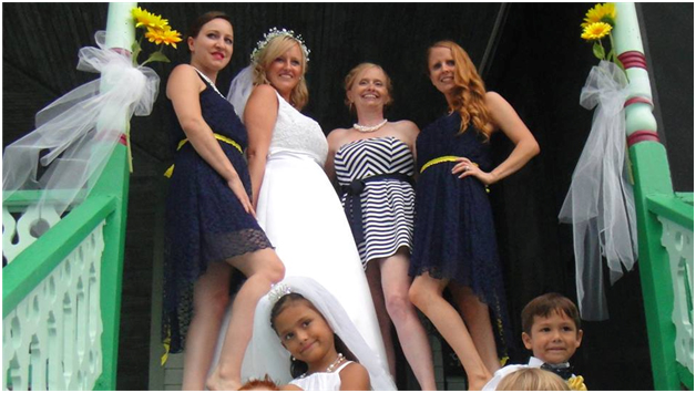 Great thrifted dress and great friends make this bride especially happy on her wedding day wearing a gently used dress purchased at Impact Thrift Store in Hatboro, PA
