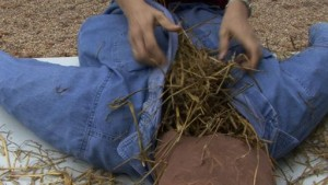 Add straw to your scarecrow to give her shape and substance inside her gently-used clothing purchased at Impact thrift stores.